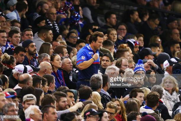 Bulldogs head coach Luke Beveridge runs down at quarter time during the round 10 AFL match between the Collingwood Magpies and the Western Bulldogs...
