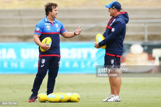 Bulldogs head coach Luke Beveridge speaks to a colleague during a Western Bulldogs AFL training session at Whitten Oval on March 20 2018 in Melbourne...