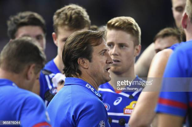 Bulldogs head coach Luke Beveridge speaks to his players during the round 11 AFL match between the Western Bulldogs and the Melbourne Demons at...