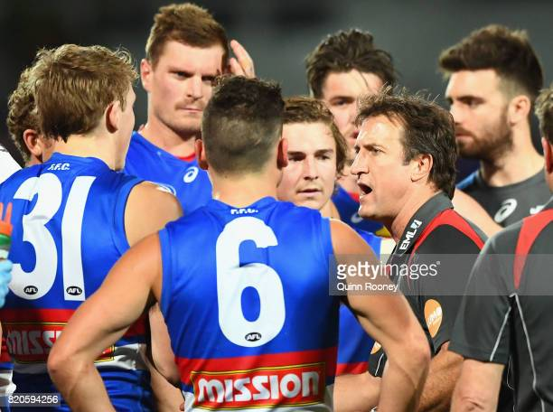 Bulldogs head coach Luke Beveridge talks to his players during the round 18 AFL match between the Western Bulldogs and the Gold Coast Suns at...