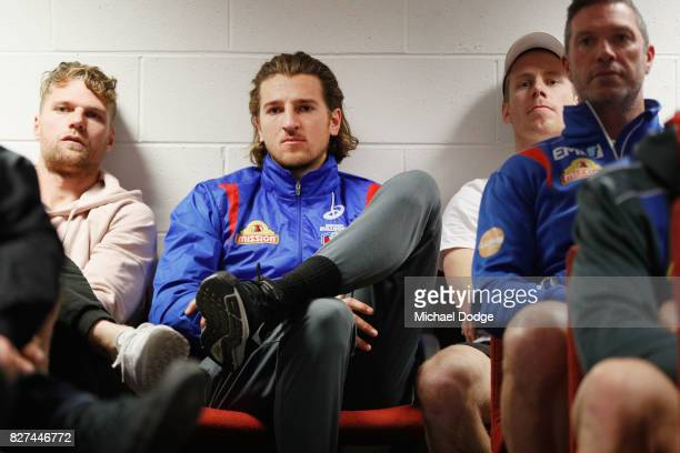 Bulldogs player Marcus Bontempelli listens as Matthew Boyd speaks to media after announcing his retirement sduring a Western Bulldogs AFL press...