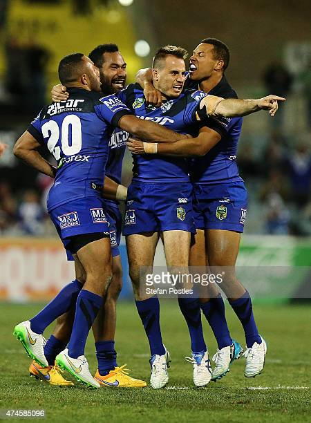 Bulldogs players celebrate after Josh Reynolds kicked a field goal to put them in front during the round 11 NRL match between the Canberra Raiders...