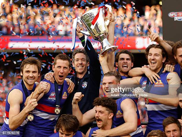 Bulldogs players celebrate during the 2016 Toyota AFL Grand Final match between the Sydney Swans and the Western Bulldogs at the Melbourne Cricket...