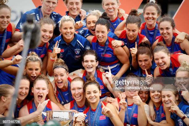 Bulldogs players celebrate during the 2018 AFLW Grand Final match between the Western Bulldogs and the Brisbane Lions at IKON Park on March 24 2018...