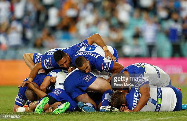 Bulldogs players celebrate their teams win in golden point time during the round four NRL match between the Wests Tigers and the Canterbury Bulldogs...