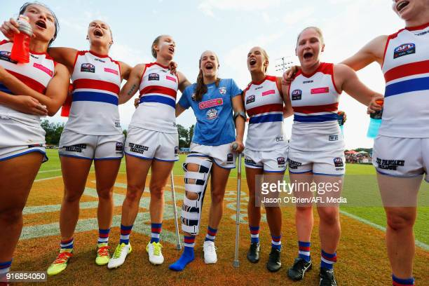 Bulldogs players celebrate their win during the round two AFLW match between the Brisbane Lions and the Western Bulldogs at South Pine Sports Complex...