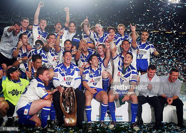 Bulldogs players celebrate victory after defeating the Roosters during the NRL Grand Final between the Sydney Roosters and the Bulldogs held at...