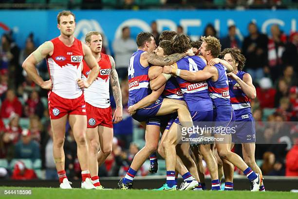 Bulldogs players celebrate winning the round 15 AFL match between the Sydney Swans and the Western Bulldogs at Sydney Cricket Ground on July 2 2016...