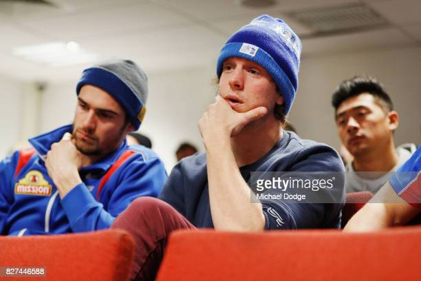 Bulldogs players Easton Wood and Liam Picken listen as Matthew Boyd speaks to media after announcing his retirement sduring a Western Bulldogs AFL...