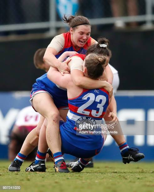 Bulldogs players Kirsty Lamb Emma Kearney and Aisling Utri celebrate on the final siren during the 2018 AFLW Grand Final match between the Western...