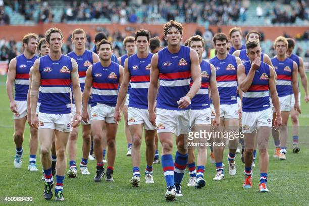 Bulldogs players leave the field after the round 14 AFL match between the Port Adelaide Power and the Western Bulldogs at Adelaide Oval on June 21...