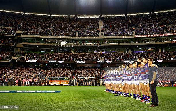Bulldogs players line up for the national anthem during the 2016 AFL Second Semi Final match between the Hawthorn Hawks and the Western Bulldogs at...