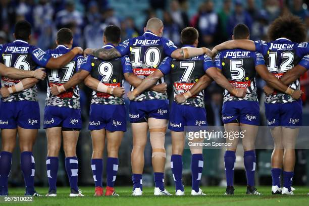 Bulldogs players line up for the national anthem during the round 10 NRL match between the Canterbury Bulldogs and the Parramatta Eels at ANZ Stadium...