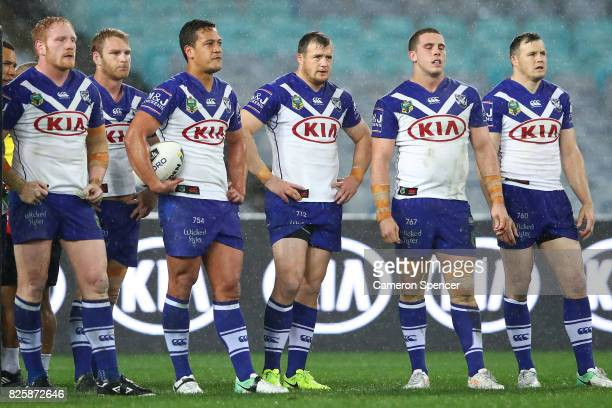 Bulldogs players look dejected after an Eels try during the round 22 NRL match between the Canterbury Bulldogs and the Parramatta Eels at ANZ Stadium...