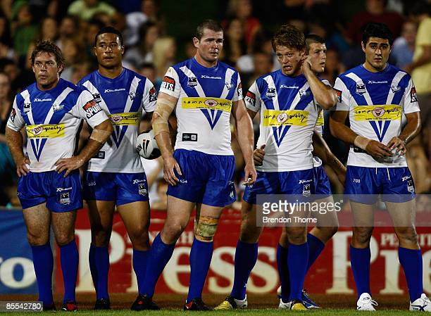 Bulldogs players look dejected after conceding a try to the Panthers during the round two NRL match between the Penrith Panthers and the Bulldogs at...