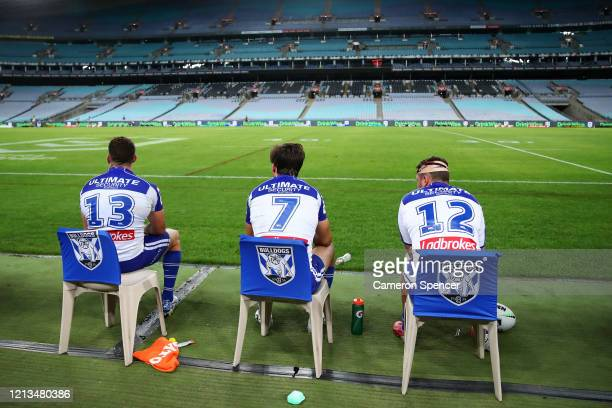 Bulldogs players observe social distancing on their bench during the round 2 NRL match between the Canterbury Bulldogs and the North Queensland...
