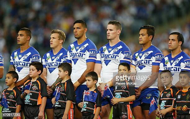 Bulldogs players stand for the national anthems during the round eight NRL match between the Canterbury Bulldogs and the Wests Tigers at ANZ Stadium...
