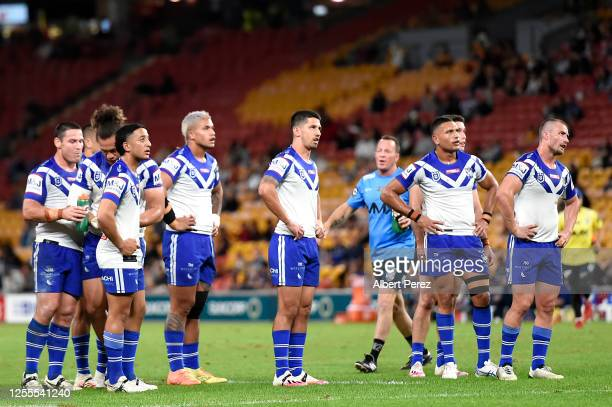 Bulldogs players wait for the result of a video review during the round nine NRL match between the Brisbane Broncos and the Canterbury Bulldogs at...
