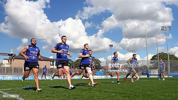 Bulldogs players warm up during a Canterbury Bulldogs NRL training session at Belmore Sports Ground on August 25 2014 in Sydney Australia