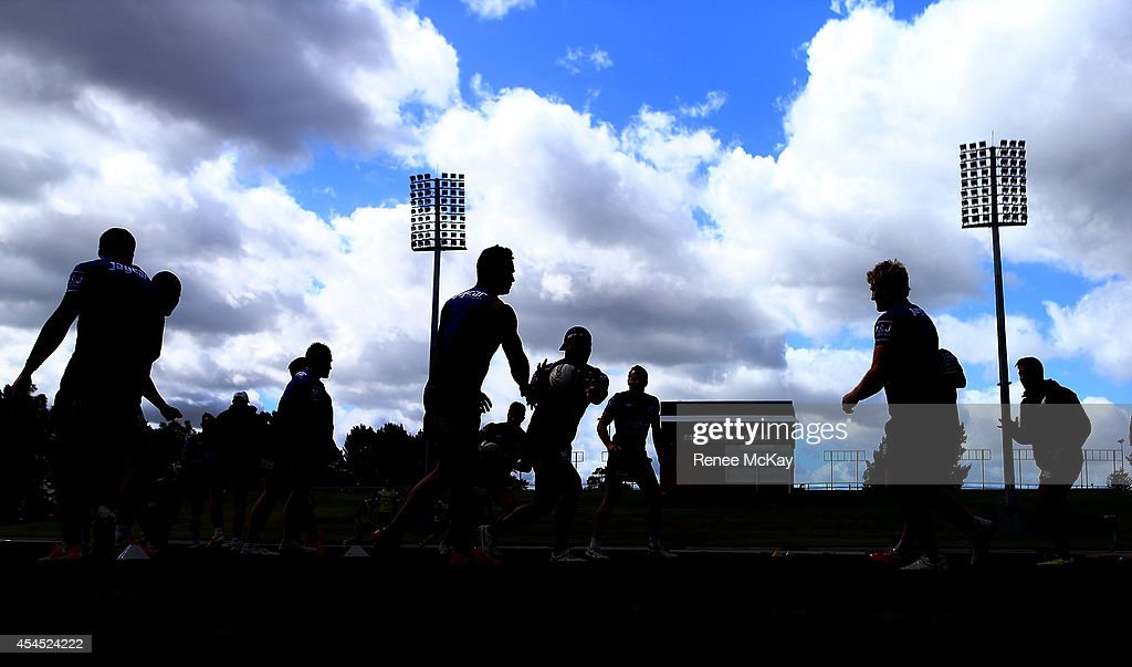 Bulldogs players warm up during a Canterbury Bulldogs NRL training session at Belmore Sports Ground on September 3, 2014 in Sydney, Australia.