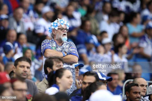 Bulldogs supporter watches on during the round one NRL match between the Canterbury Bulldogs and the Melbourne Storm at Belmore Sports Ground on...