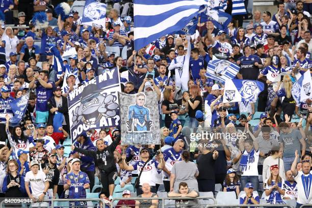 Bulldogs supporters cheer during the round 26 NRL match between the St George Illawarra Dragons and the Canterbury Bulldogs at ANZ Stadium on...