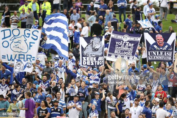 Bulldogs supporters cheer during the round one NRL match between the Canterbury Bulldogs and the Melbourne Storm at Belmore Sports Ground on March 3...