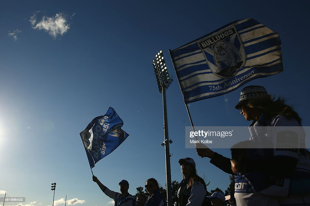 Bulldogs supporters on the family hill wave flags as they wait for the start of the round 20 NRL match between the Canterbury Bulldogs and the Cronulla Sharks at Belmore Sports Ground on July 26, 2015 in Sydney, Australia.