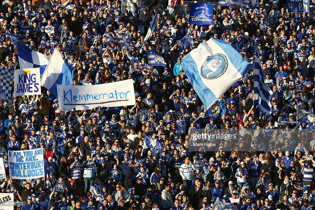 Bulldogs supporters on the hill cheer as their team take the field during the round 20 NRL match between the Canterbury Bulldogs and the Cronulla Sharks at Belmore Sports Ground on July 26, 2015 in Sydney, Australia.