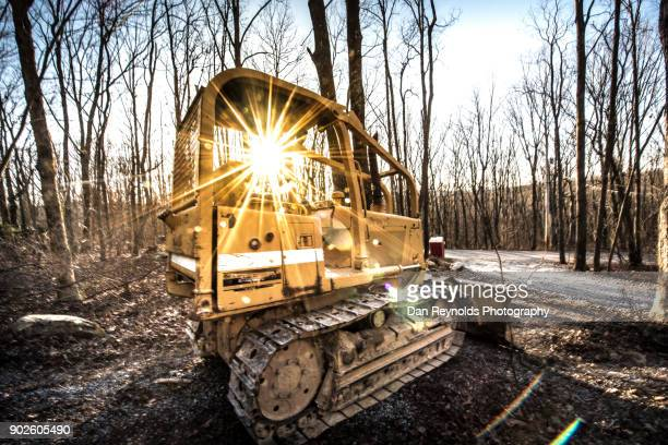 Bulldozer at Construction Site with Sunstar