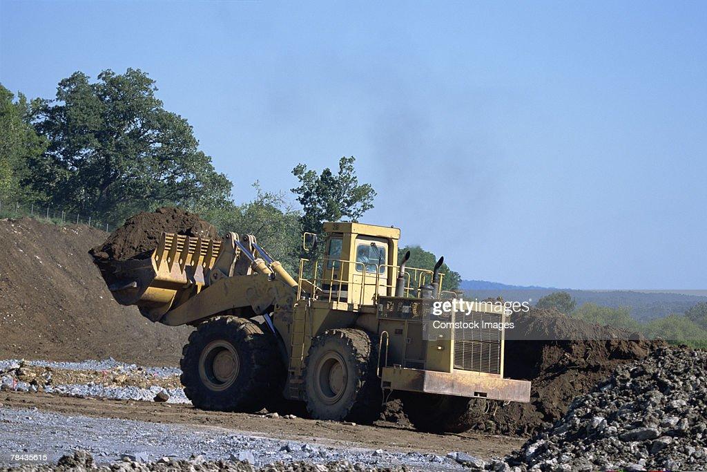 Bulldozer at road building site : Stockfoto