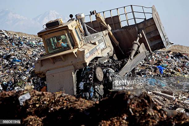 A bulldozer churns through mounds of garbage at the Puente Hills Landfill facility It is the biggest active landfill in the nation Every day more...