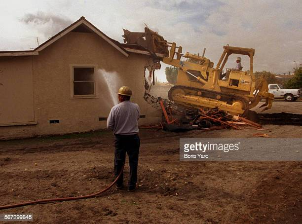 bulldozer demolishes house on lot that will become part of Vaught Next Century Learning Center in Pacoima ^^^/LA Times