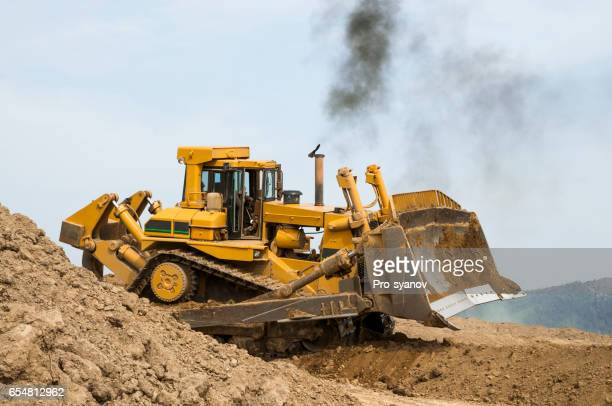Bulldozer in open field operation