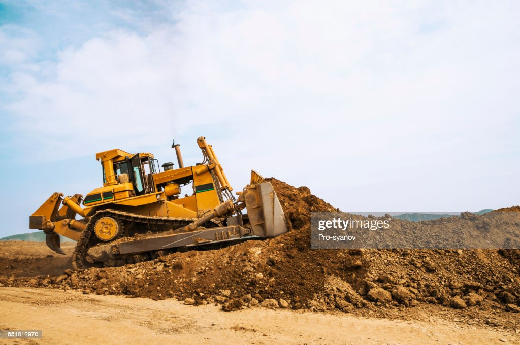Bulldozer in open field operation : Stock Photo