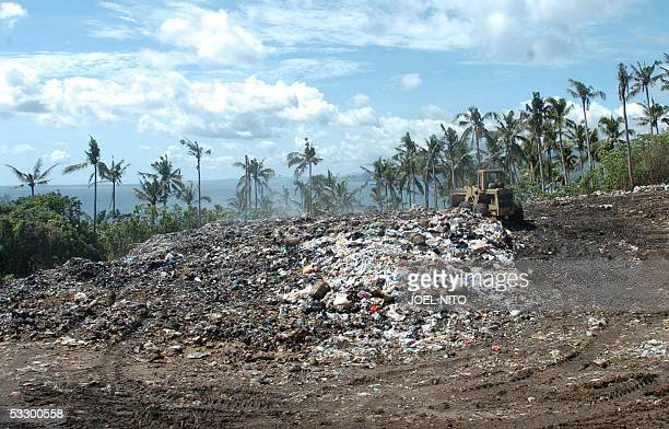 STORY PHILIPPINESTOURISMENVIRONMENTBORACAY A bulldozer moves the piles of garbage that have been dumped on a hillside in the central Philippine...