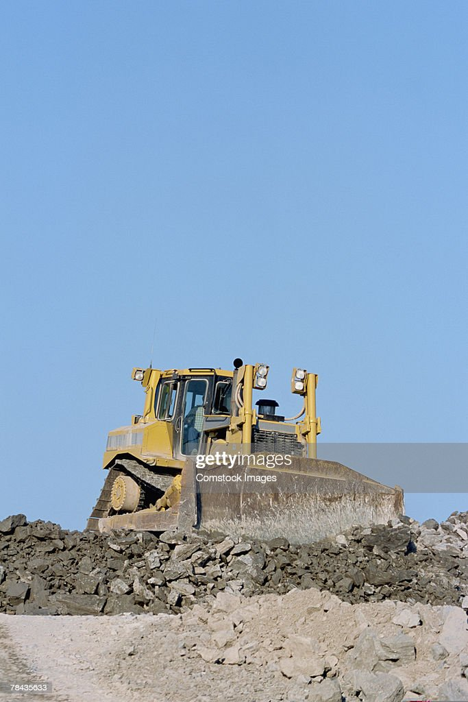 Bulldozer moving dirt at road building site : Stockfoto