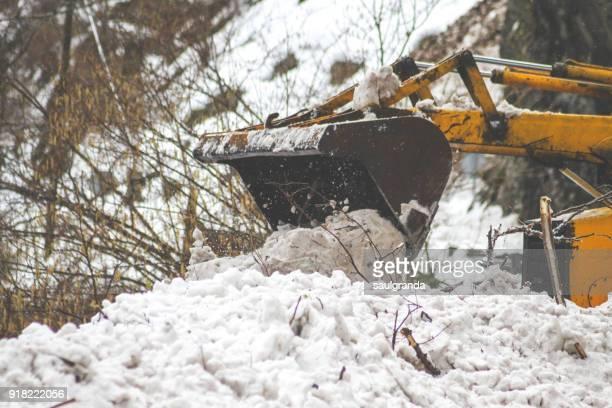 A bulldozer on a snow avalanche