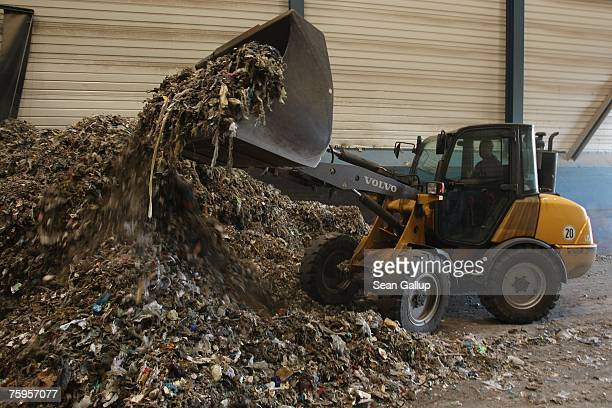 A bulldozer pushes highenergy grade garbage at a portion of the city's power plant that has been converted to burn garbage August 3 2007 in...