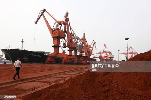 Bulldozer scoop soil containing various rare earth to be loaded on to a ship at a port in Lianyungang east China's Jiangsu province on September 5...