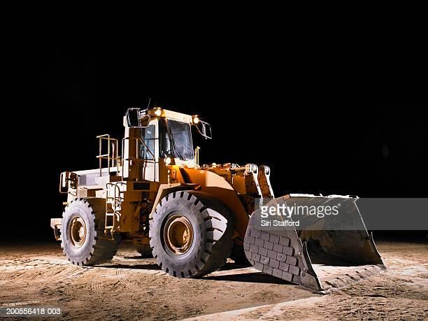 Bulldozer with shovel lowered