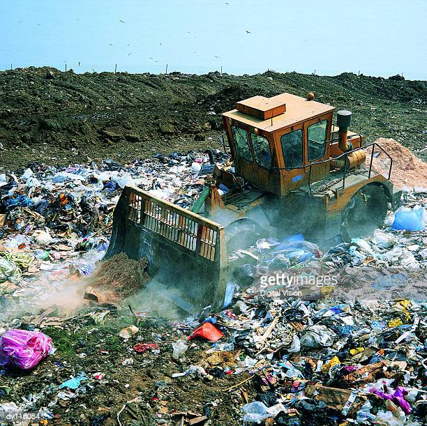 Bulldozer working on landfill site,UK