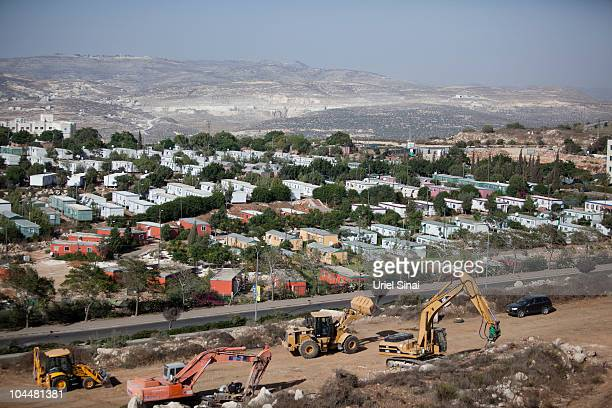 Bulldozers begin constructing a new neighborhood on September 27 2010 in the Jewish settlement of Ariel in the West Bank Work also to resume...