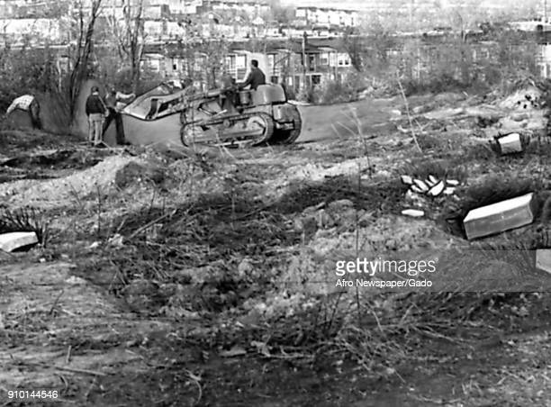 Bulldozers demolish Laurel Hill Cemetery a historically AfricanAmerican cemetery in Baltimore Maryland in preparation for the construction of the...