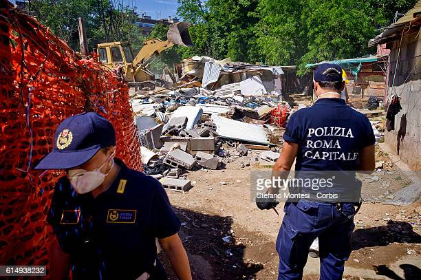 Bulldozers demolish the settlement of the migrants near the metro station of Ponte Mammolo, inhabited by about 400 migrants for the most asylum...