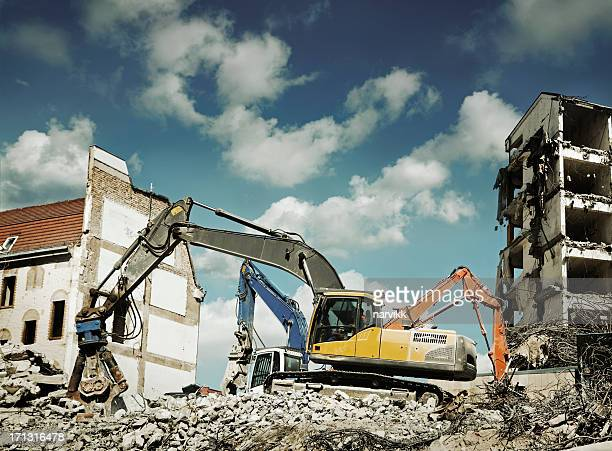 Bulldozers destroying old houses