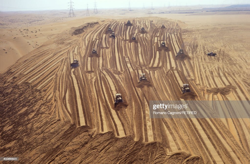 Bulldozers levelling a section of desert in the United Arab Emirates, before the area is converted to agricultural use, circa 1990.