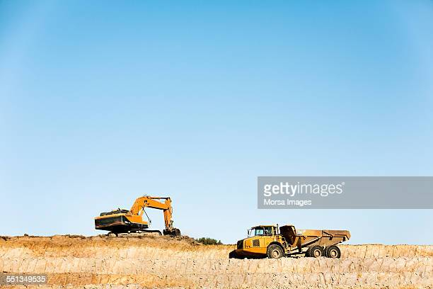 Bulldozers on quarry