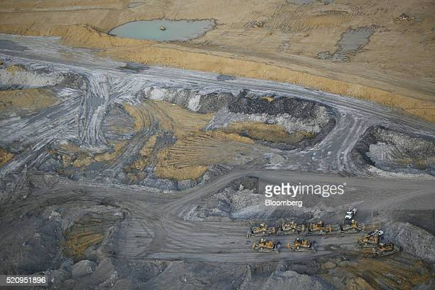 Bulldozers sit in this aerial photograph taken above the Peabody Energy Corp Wild Boar coal mine in Lynnville Indiana US on Tuesday April 5 2016...