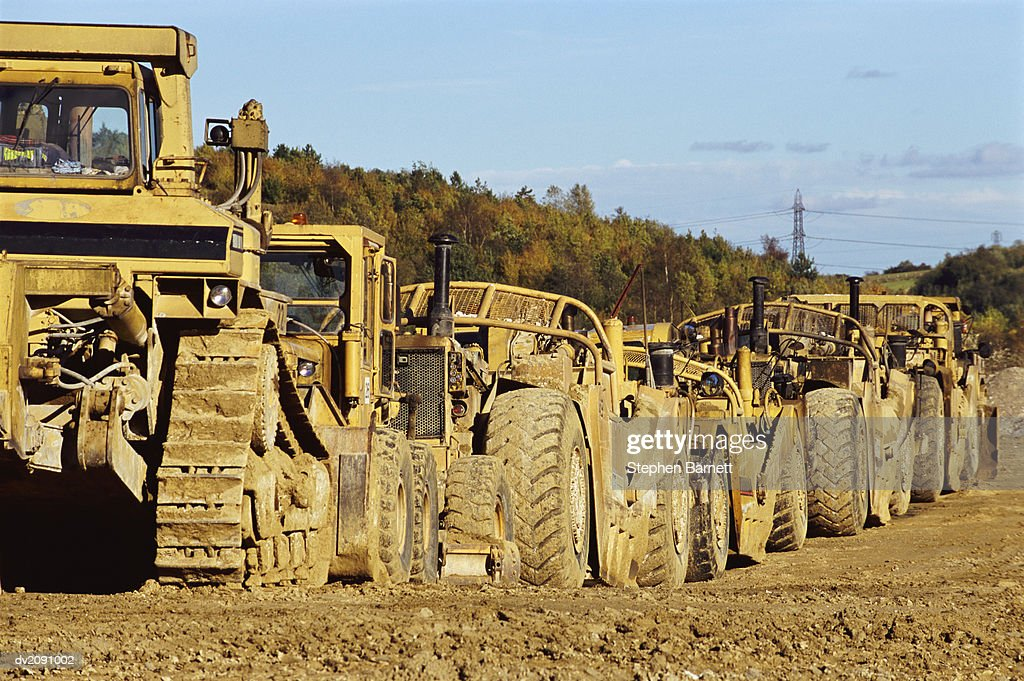 Bulldozers Stationary, in a Line : Stock Photo